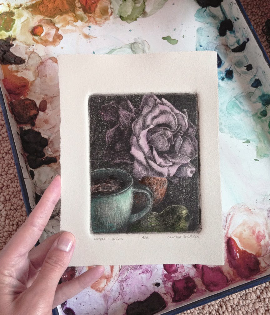 a drypoint print of a rose, a mug and a bird figurine from a sheet of plexiglass, painted with watercolors